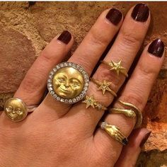#repost from @jewelrynerd of a fully adorned hand decked out in our rings! Happy Friday everyone! #luxurywithaface #moonface #celestial #rings #showmeyourrings #stackingrings #moonring #baltimore #shopbaltimore #tgif