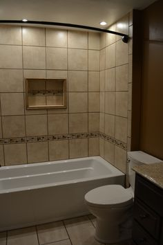 Ceramic Tile Tub Surround With Niche And Mosaic Accents Coordinating Floor In 12x24
