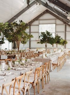 photo: Sylvie Gil; simple chic wedding reception idea with green color details