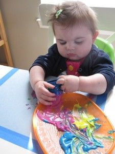 Painting with blocks- don't forget to tape the paper to the table!