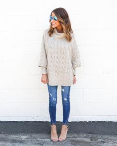 Our London Sweater is for lovers! This tan chunky knit sweater is so fashion forward with dolman sleeves! The zippers that descend the sweater are functional while the mock turtleneck keeps you warm a