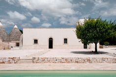"""The building is an atypical example of Masseria, due to the plan in linear form which differs from the traditional """"court yard"""" shape. Through a historical ana… Barcelona Architecture, Studios Architecture, Architecture Design, Retreat House, Rustic Italian, Austin Homes, Mansions Homes, Beautiful Villas, Brick And Stone"""