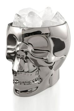 "Voodoo Ice Bucket & Candle Holder by Stokes Keep your spirits cool with this silver skull ice bucket and candle holder. - Capacity: 33.0 oz. - 18.5"" H x 15.5"" W x 15"" D - Imported  Orders cannot be shipped to Canada, Alaska, Hawaii, Puerto Rico or P.O. Boxes. Materials Glass Care Info Hand wash $25.00"