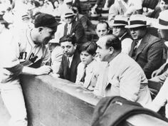 Chicago Cubs catcher Gabby Hartnett autographs a baseball for Al Capone's son, Al Jr. (Sonny), at a charity game between the Cubs and the Chicago White Sox in (Bettmann/Corbis) Chicago Baseball, Baseball Photos, Baseball Games, Chicago White Sox, Chicago Cubs, Al Capone, Mafia, Cubs Players, Baseball Promposals