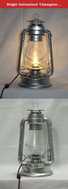"Bright Galvanized 'Champion' Electric Lantern Table Lamp. Enjoy nostalgic lantern lighting anywhere! This electric lantern lamp is the largest and best selling of our modernized kerosene-to-electric lantern lamps. Electric Lantern lighting provides safe, nostalgic old fashioned lighting just about anywhere you can imagine, without the mess or smell of kerosene or oil. This lantern lamp stands right at 15"" tall (bail down) with a 8"" base and features a 7-8 foot electrical cord with in-line..."