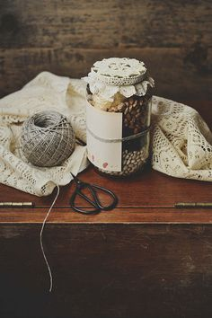 Sewing supplies and buttons in a mason jar