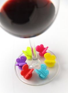 These set of 6 Gift Concepts Butterfly Wine Glass Markers are a cool way to identify friends wine glasses when throwing a party. The butterfly marker is designed with a suction that can stick on all kinds of glasses.