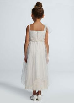 Your flower girl will look just as fierce as you on your special day in this mini bridal gown!  Spaghetti strap soft netpleated bodicefeatures one shoulder streamer at sleeve.  Beadedlace embroidered appliques at waist is ultra-chic.  Coordinates with Galina Signature style SWG579.  Fully lined. Back zip. Imported polyester. Dry clean only.