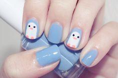 baby blue penguin nails.