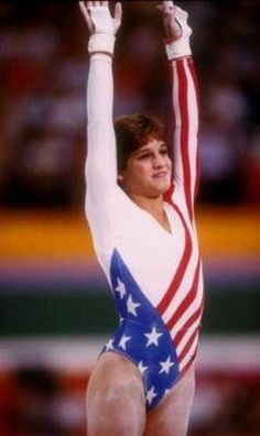 When I took gymnastics, I had this same outfit! She was my idol! Mary Lou Retton became the first American woman to win the all-around gymnastics gold medal at the Olympics Olympic Gymnastics, Olympic Sports, Olympic Games, Gymnastics News, Gymnastics History, Gymnastics Pictures, Gymnastics Girls, Mary Lou Retton, 1984 Olympics