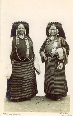 Old Tibet. two noble Lhasa women in traditional Tibetan costumes of their region . 19th century