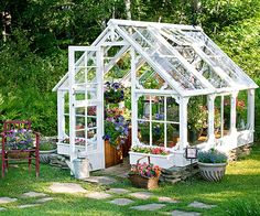 This small DIY greenhouse is made from the windows of an old dairy farm. Source: BHG.
