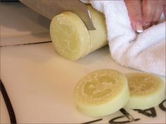 Loofah Soap place brick of ready-melt soap (honey or goat milk) in top of double boiler or microwave till melted.  place cut loofah in soap molds.  pour enough soap in soap mold till loofah slice is just covered. wait 30 min for soap to harden.