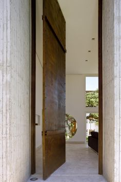 Located in Brasilia, Brazil, Taquari House is a private residence designed by Ney Lima. The home has a stunning exterior architecture and accompanying land House Doors, House Entrance, Entrance Doors, Grand Entrance, Doorway, External Hardwood Doors, Pine Doors, Space Architecture, Windows And Doors