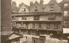 "Gray's Inn Lane, 1885. In 1827, Dickens was sent to work as a clerk at Gray's Inn for a friend of his father's. He later described it as ""one of the most depressing institutions in brick and mortar known to the children of men"". These houses on the lane were demolished to widen the road in 1878-9."