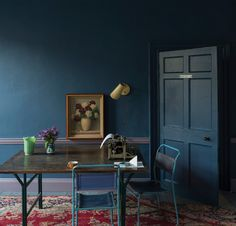 A beautiful old Persian rug with blues and reds could be the starting place for a room that incorporates deep, moody blues, says designer Michael Roberson. This room gets a nice, strong dose of Farrow & Ball's Stiffkey Blue paint. Farrow Ball, Dark Walls, Blue Walls, Dark Interiors, Colorful Interiors, Stiffkey Blue, Interior And Exterior, Wall Colors, Bedroom Ideas