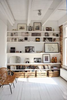 "start a new trend Let's change up the standard gallery wall. Float shelves to house leaning artwork and books. Store your record collection in neat bins to save space. Make your display floor-to-ceiling to maximize space, and add in souvenirs and photos for a personal touch. Finally, a place for the kids' ""abstract"" art."