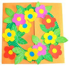 Une carte en couronne de fleurs.