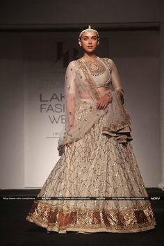 Actress Aditi Rao Hydari turned showstopper for designer Jyanti Reddy. She was a vision in an off-white and gold lehenga. She finished her look with traditional jewellery.