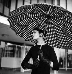 Ciao Bellissima - Vintage Glam; Isabella Albonico wearing a black and white check silk hair bow by Sally Victor with an oversized umbrella by Uncle Sam, March 1958