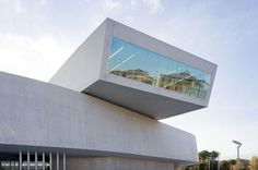 Zaha Hadid's design for the cutting edge art museum in Rome, the Maxxi, is an example of a contemporary building that acknowledges its context.  The window in this image reflects the surrounding historical buildings of the neighborhood and incorporates them into the new design.