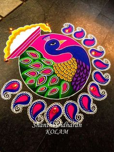 Simple and Unique Multicolor Rangoli Designs - ArtsyCraftsyDad Source by darshitapaghadal. Rangoli Designs Peacock, Best Rangoli Design, Indian Rangoli Designs, Rangoli Designs Latest, Simple Rangoli Designs Images, Free Hand Rangoli Design, Rangoli Border Designs, Small Rangoli Design, Rangoli Patterns
