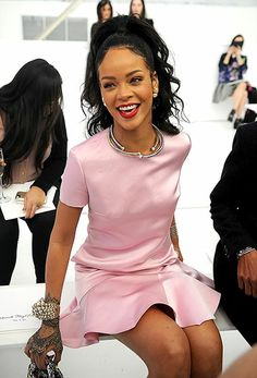 Rihanna looked ladylike in a pink frock with gold and silver jewelry at the Dior Cruise 2015 Fashion Show in Brooklyn, N.Y., on May 7.