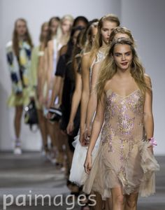 Cara Delevingne (front) in the Topshop catwalk show at the Topshop Show Space in London during London Fashion Week.