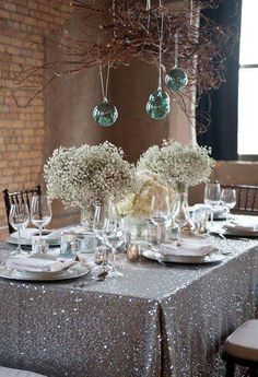 Bold linens offset by natural and simple centerpieces and twig decor