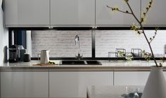 Our Clerkenwell Gloss Dove Grey kitchen range by Howdens.