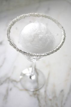 sparkle rimmed glass with frozen champagne sorbet