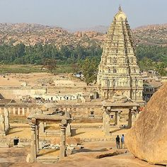This is Hampi, the religious center of Vinayanagara - the last great Hindu empire from the 14th century. It is magical place where ancient ruins and boulders balance like they are defying the laws of gravity.  🐒🐍🐮  #hampi #karnataka #india #incredibleindia #ruins #vijayanagara #shiva #hanuman #hindu #empire #travel #magic #girlswhotravel #seetheworld #wanderlust #wanderlustwednesday