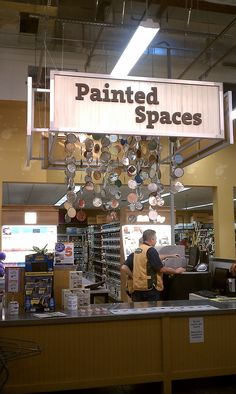 I love this display because it's in a hardware store- a place that doesn't usually lend itself to artful displays and creativity (although they should- they have all of the tools and materials at their fingertips!). This is a compilation of paint can lids with colorful dried paint on them, suspended like a mobile from the ceiling.