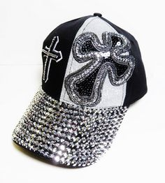 Blinged Out Black and Silver Stone Double Cross Baseball Cap with Adjustable Back!!  Super Sparkly and Priced at only $24.99!  Go to our Amazon Store to purchase by Clicking on this link: http://www.amazon.com/Womens-Silver-Double-Baseball-Headwear/dp/B00T8KTW34/ref=sr_1_21?m=A1FEC2X9F0DT1J&s=merchant-items&ie=UTF8&qid=1423949007&sr=1-21&keywords=cross+baseball+cap
