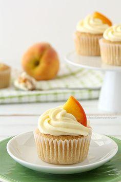 Peaches and Cream Stuffed Cupcakes | www.chocolatemoosey.com