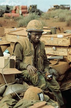 Mar 1968, Khe Sanh, South Vietnam - U.S. Marine, seated listening to his radio equipment during a lull in the shelling of the base. - © Bettmann/CORBIS ~ Vietnam War
