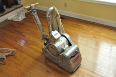 Step 1: Drum Sand Floor: To remove the majority of the existing finish and stain, Danny's crew used an 8″ drum sander. They started off with a 36 grit sanding belt.