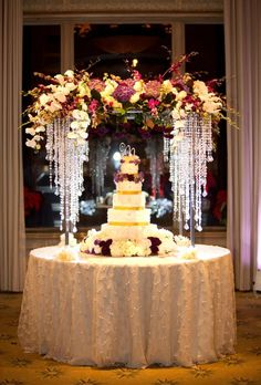 Glamorous Wedding Cake Table Ideas for Spectacular Wedding Decor- A young man and young woman will be so busy to prepare their big day, wedding. There are numerous things to prepare before a wedding including the sui. Wedding Table Flowers, Wedding Table Centerpieces, Reception Decorations, Reception Ideas, Flower Table, Cake Tables For Weddings, Tall Flower Centerpieces, Quince Centerpieces, Crystal Centerpieces