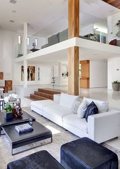 Not this style at all - but here is an example of a loft with a white square pillar and a wooden pillar