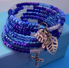 """This """"Cool Water Iridescent"""" Wrap Bracelet is strung on stainless steel memory wire and it wraps around your wrist six times in six shades of Blue"""