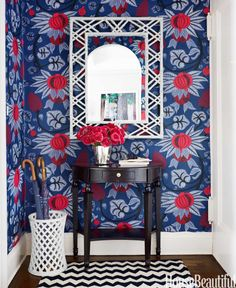 """A bold graphic wallpaper will make an eye-catching first impression. Plus, if you don't have a closed-off foyer, it will delineate the spot from the rest of your home. Designer Ashley Whittaker used Osborne & Little's Maharani wallpaper for the entry in a Manhattan apartment: """"Billy Baldwin said you should start with a dark space and work your way through the apartment, lightening rooms as you go."""""""