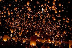 "during the festival of yee peng in thailand, ""khom loy"" or floating lanterns are released into the sky... looks so magical"