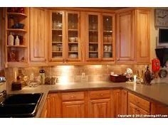 honey oak kitchen cabinets with black countertops Top of the