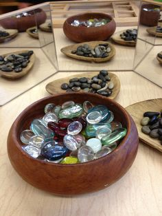 Glass pebble display and mirror reflection. Image uploaded by Anne Scalley http://www.pinterest.com/ann2/pins/