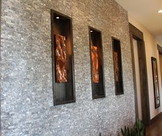 modern use of veneer stone and home accent items to create style and atmosphere