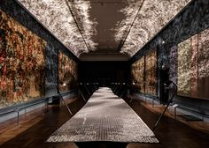 50,000 metal triangles make up British designer Benjamin Hubert's undulating Foil installation, which casts light onto the V&A's medieval tapestries.