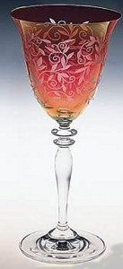 """Miller Rogaska Venetian Ruby Wine by Reed And Barton. $17.99. 8.5"""" Tall. Red bowl with iridescent sheen ,  clear stem. Fine Crystal. Add a touch of elegance and shimmering color to your table with Miller Rogaska's Venetian Ruby wine glasses. This exquisite 8.5"""" tall crystal wine glass features a ruby red bowl with stylized floral detailing and an iridescent sheen that seems to change color when viewed from different directions. The stem is clear, creating a striking ..."""