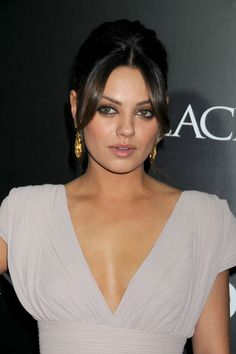 Mila Kunis French Twist - Mila Kunis added an elegant touch to her plunging neckline with a classic French twist complete with face framing bangs.