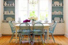 .Love the idea of having the table a different color than the chairs