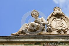 Classic female sculpture as ornament of an old building in historical center of Brasov city, Romania.